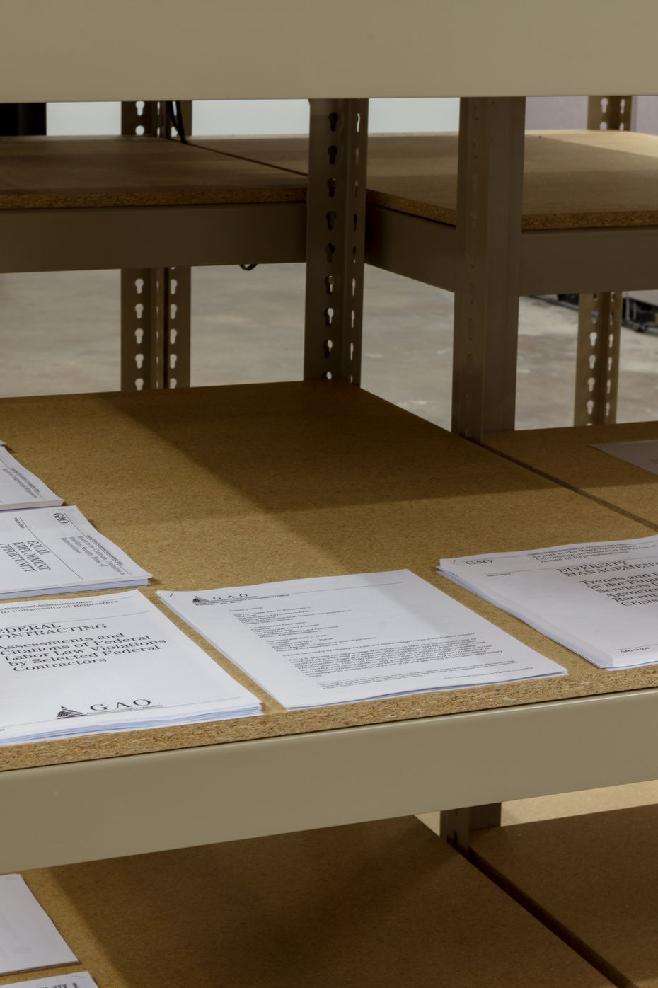 Printouts of various U.S. government reports are included in the exhibition.