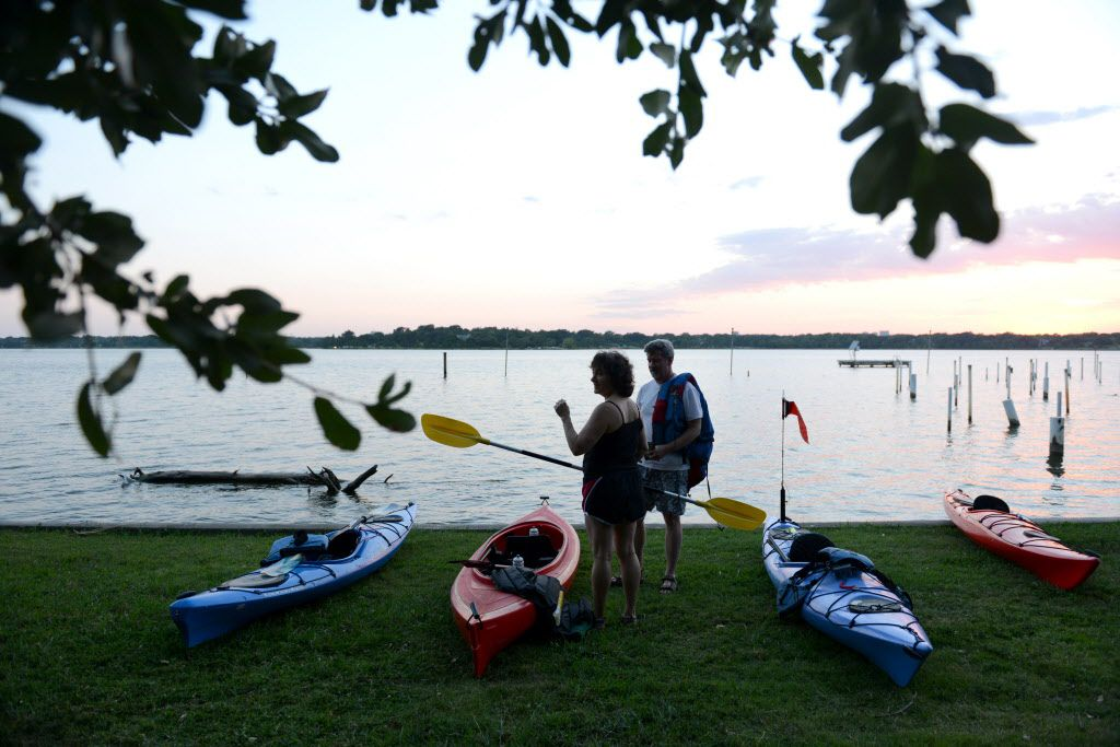 Kayakers with the Dallas Downriver Club for a moonlight paddle at White Rock Lake in Dallas on Aug. 9, 2014.