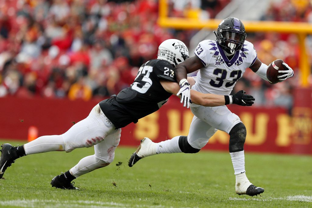 TCU running back Sewo Olonilua (33) is tackled by Iowa State linebacker Mike Rose (23) during the first half of an NCAA college football game, Saturday, Oct. 5, 2019, in Ames, Iowa. (AP Photo/Charlie Neibergall)