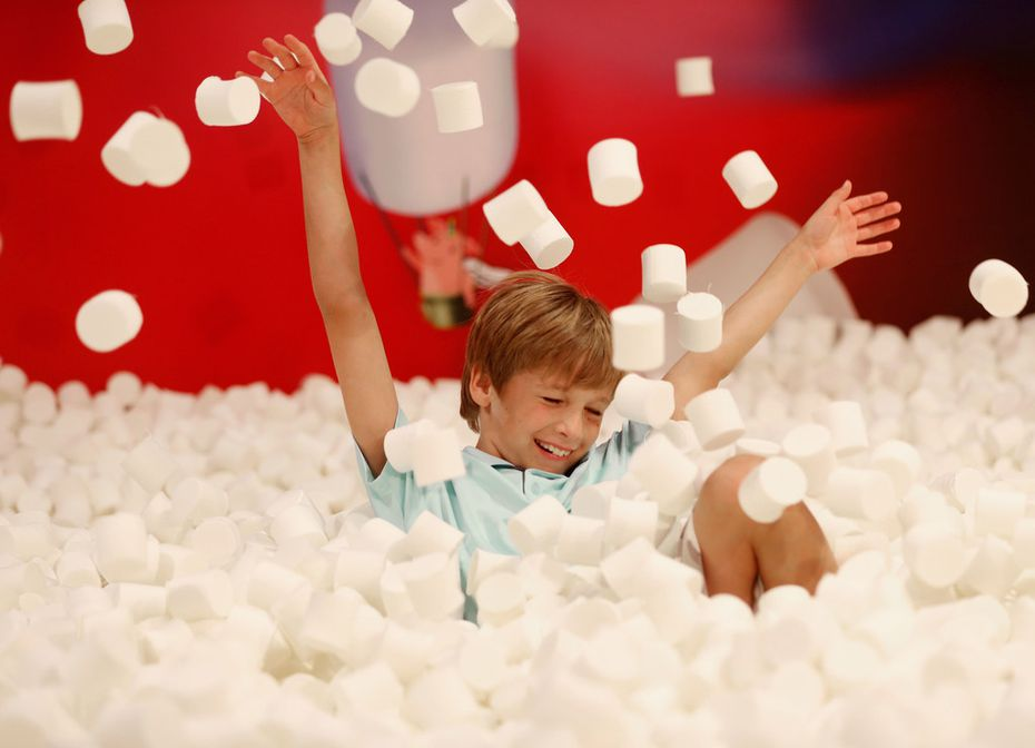 William LeBlanc, 9, plays in the marshmallow pit at Candytopia.
