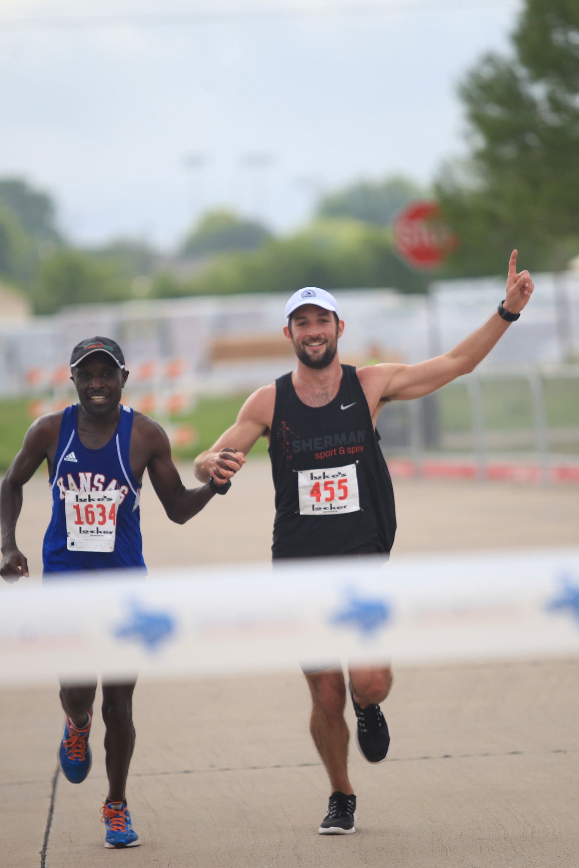 Benson Chesang and Logan Sherman as they finished the 2016 Texas Big Star Half Marathon.