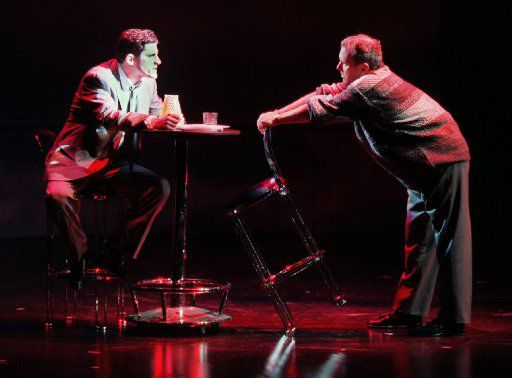 Robert Gomes as Joe Pitt (left)  and Stephen Markle as Roy Cohn in Dallas Theater Center's 'Angels In America: Millenium Approaches