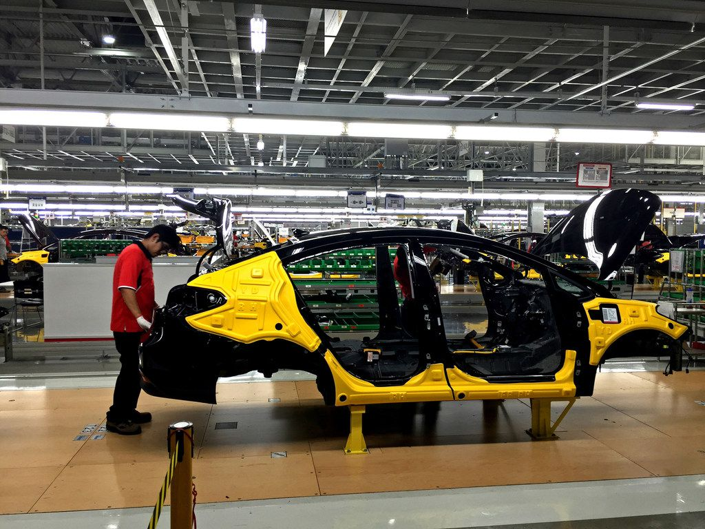 Workers assemble the Forte sedan on the floor of a Kia plant in Nuevo Leon, Mexico, which began production in May.