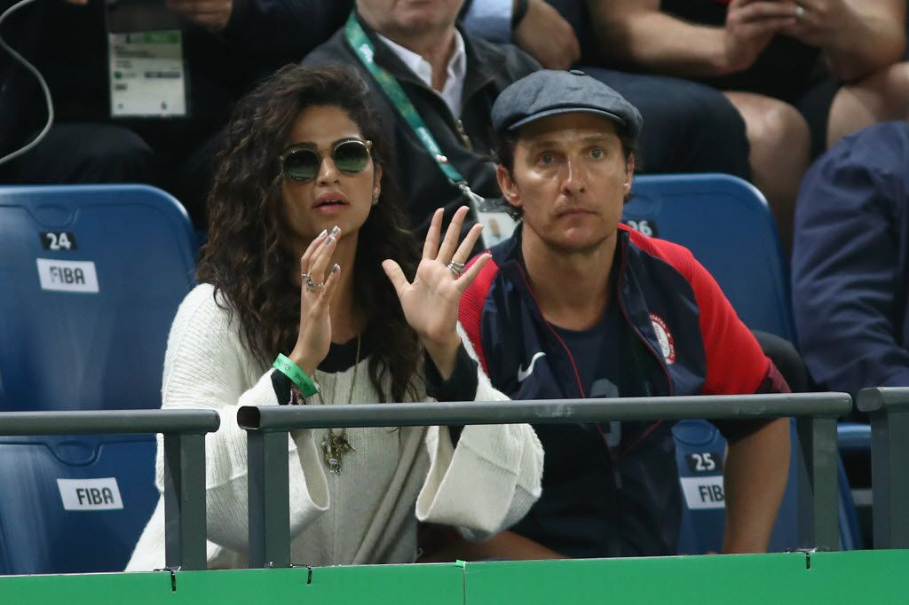 RIO DE JANEIRO, BRAZIL - AUGUST 10:  Actor Matthew McConaughey and wife Camila Alves watch the Men's Preliminary Round Group A game between Australia and the United States on Day 5 of the Rio 2016 Olympic Games at Carioca Arena 1 on August 10, 2016 in Rio de Janeiro, Brazil.
