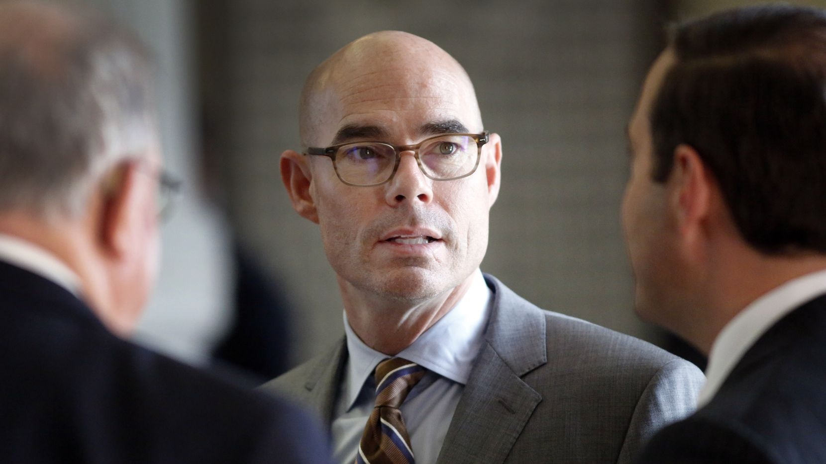 Texas House Speaker Dennis Bonnen (center) was accused by a conservative political activist of targeting fellow Republicans in the primary.