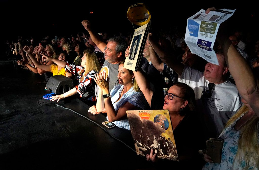 Fans of the Steve Miller Band try to get his attention by waiving record albums during the end of the concert at the Majestic Theatre in San Antonio, Texas, Wednesday, July 25, 2018. Steve is currently on his 50th Anniversary Tour and will perform at the Allen Event Center in Allen, Friday, July 27, 2018. (David Woo Photo)
