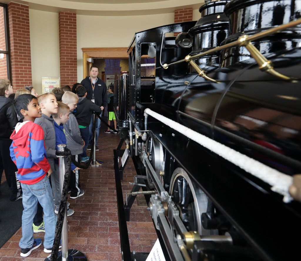 Third-graders from Frisco ISD's Tadlock Elementary look at the miniature steam locomotive as part of their tour of the Frisco Heritage Museum.
