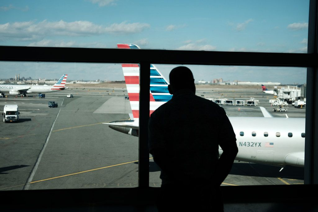 Planes sat on the tarmac at at LaGuardia Airport after the Federal Aviation Administration announced Friday that it was  delaying flights into multiple airports due to staffing concerns related the government shutdown.