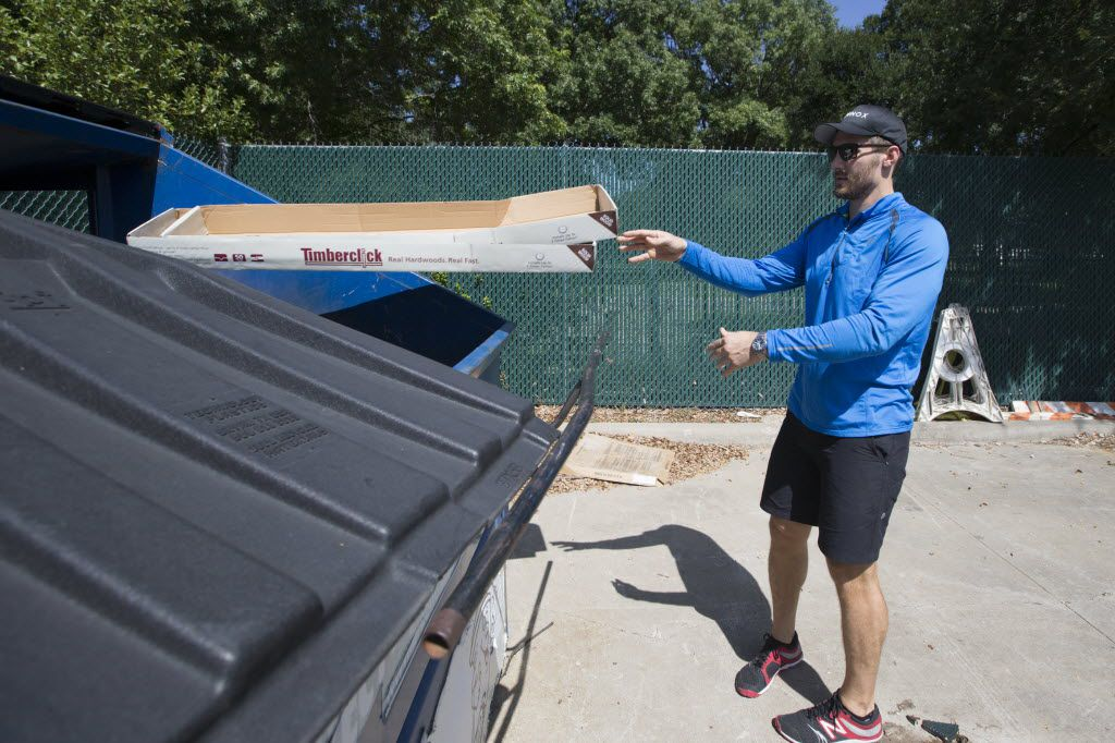 Eric Gibbs, of Dallas, tosses recyclable waste in to a Dallas Sanitation Services Department community recycling container at the Temple Emanu-El location on Aug. 6, 2016 in Dallas, Texas. (Ting Shen/The Dallas Morning News)