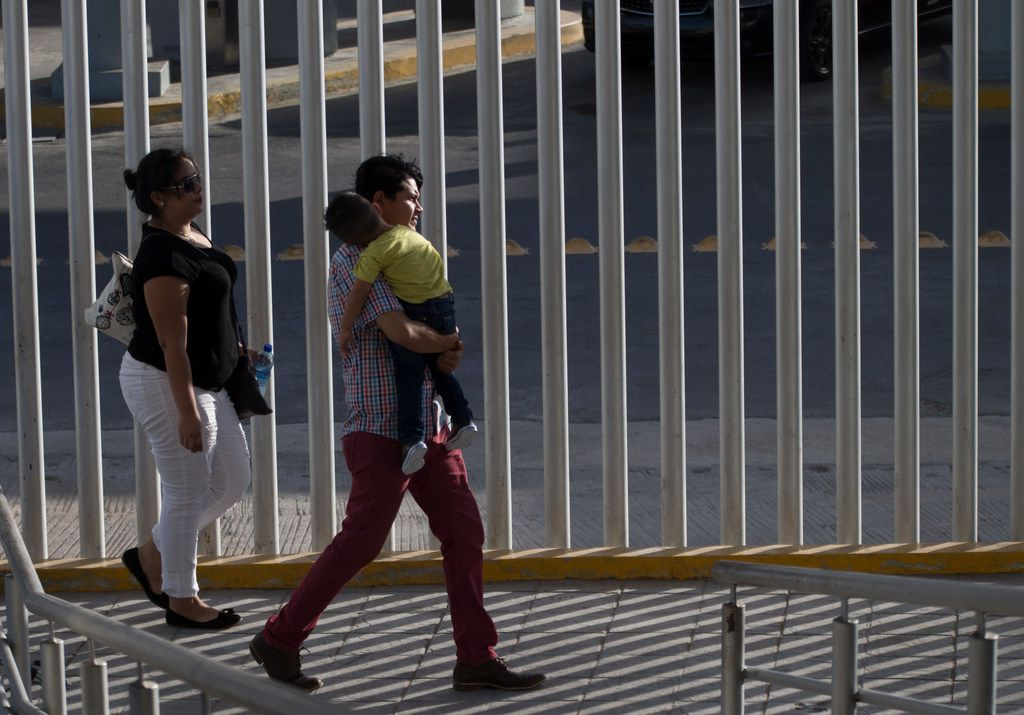 People cross from the Mexico side of the walking bridge between Hidalgo, Texas, and Reynosa, Mexico, on June 9, 2018.