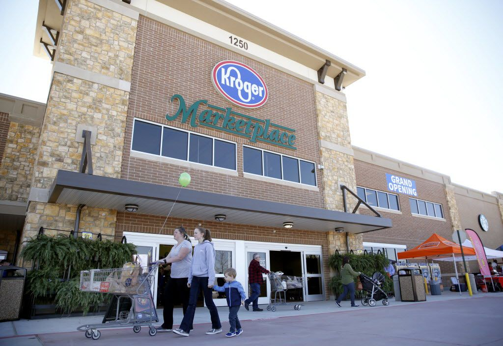 Shoppers walk through the entrance of the Kroger Marketplace in Prosper.