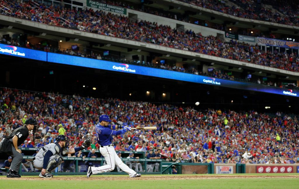 Texas Rangers catcher Robinson Chirinos (61) hits a home run against Tampa Bay Rays during their game at Globe Life Park in Arlington, Texas Oct. 1, 2016.  (Nathan Hunsinger/The Dallas Morning News)