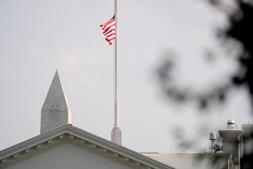"""The American flag files at half-staff at the White House, Aug. 27, 2018, in Washington. Two days after Sen. John McCain's death, President Donald Trump says he respects the senator's """"service to our country"""" and has signed a proclamation to fly the U.S. flag at half-staff until his burial. The flag atop the White House flew at half-staff over the weekend but was raised Monday and then lowered again amid criticism. (AP Photo/Andrew Harnik)"""