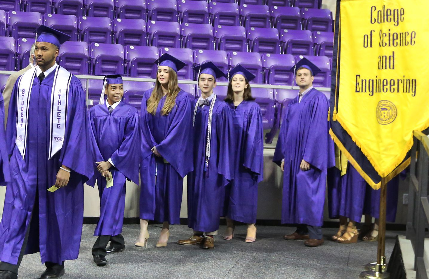 14-year-old Carson Huey-You, second from left, walks into the arena with fellow students as he prepares to receive a bachelor's degree in physics at the TCU commencement held in Fort Worth on Saturday, May 13, 2017.