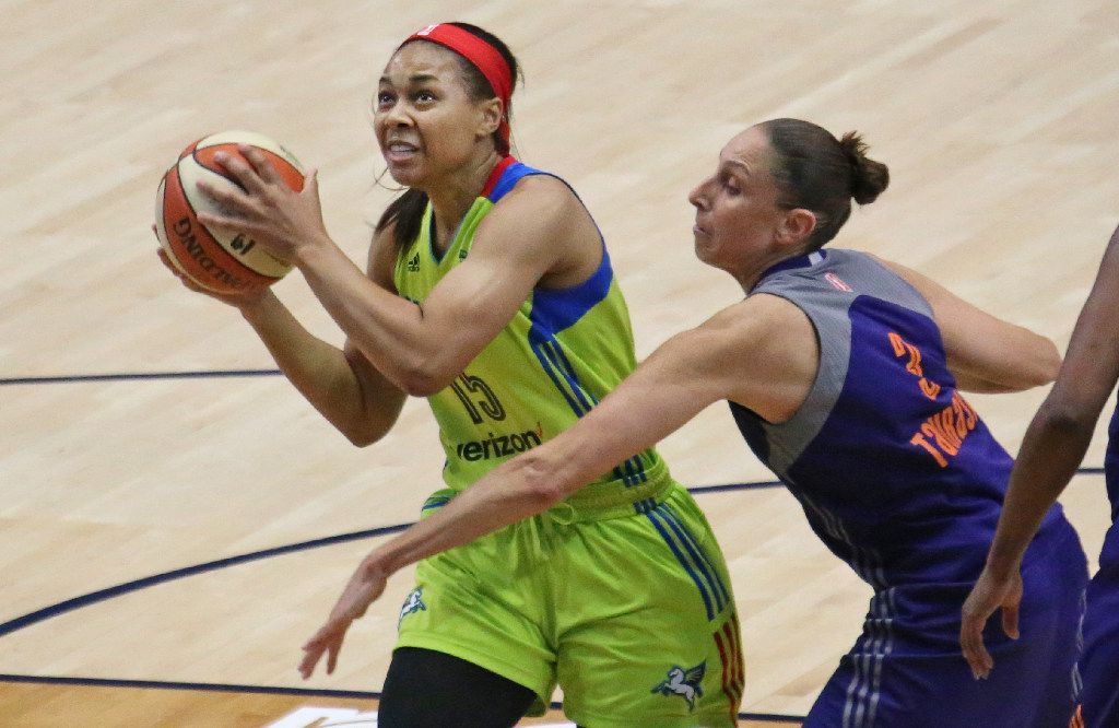 Dallas Wings guard Allisha Gray (15) drives past Phoenix Mercury guard Diana Taurasi (3) during the Dallas Wings vs. Phoenix Mercury WNBA basketball game at the UTA College Park Center in Arlington, Texas on Thursday, August 10, 2017. (Louis DeLuca/The Dallas Morning News)