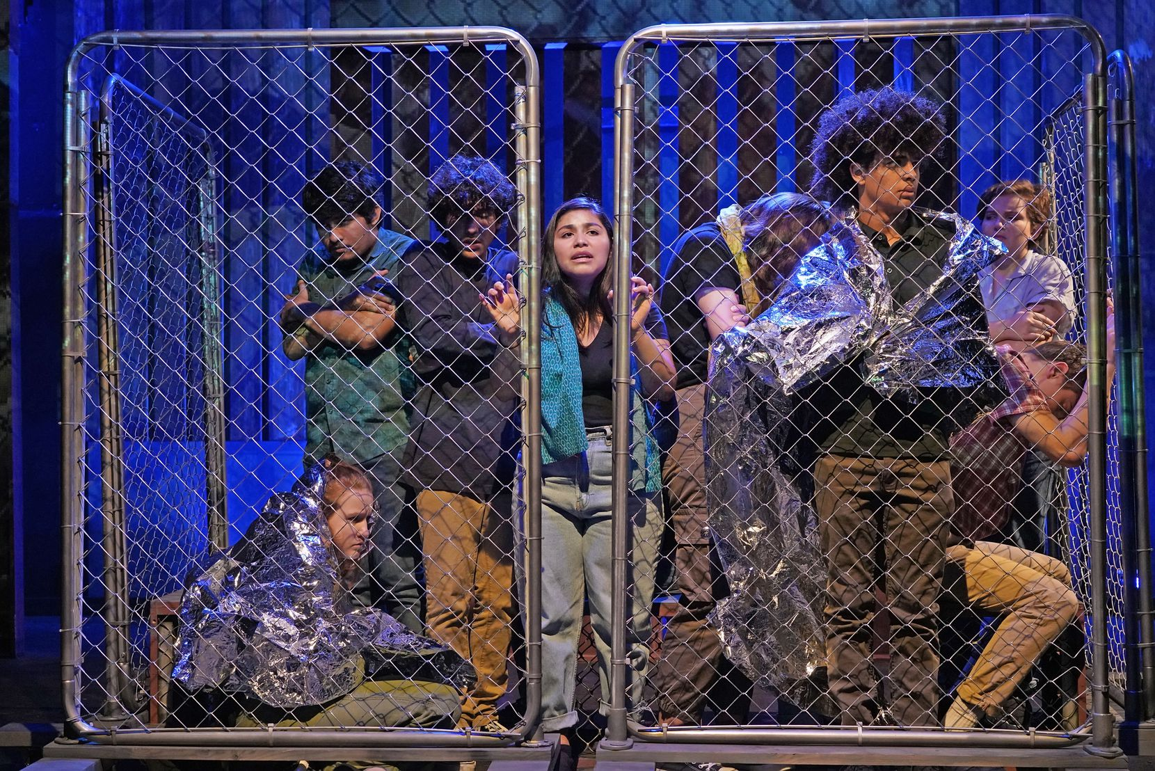 Teen actors from Cry Havoc Theater Company depict immigrants being held at the border in Crossing the Line, their documentary play created out of a trip to South Texas and Mexico, where they observed and interviewed people on all sides of the controversy.