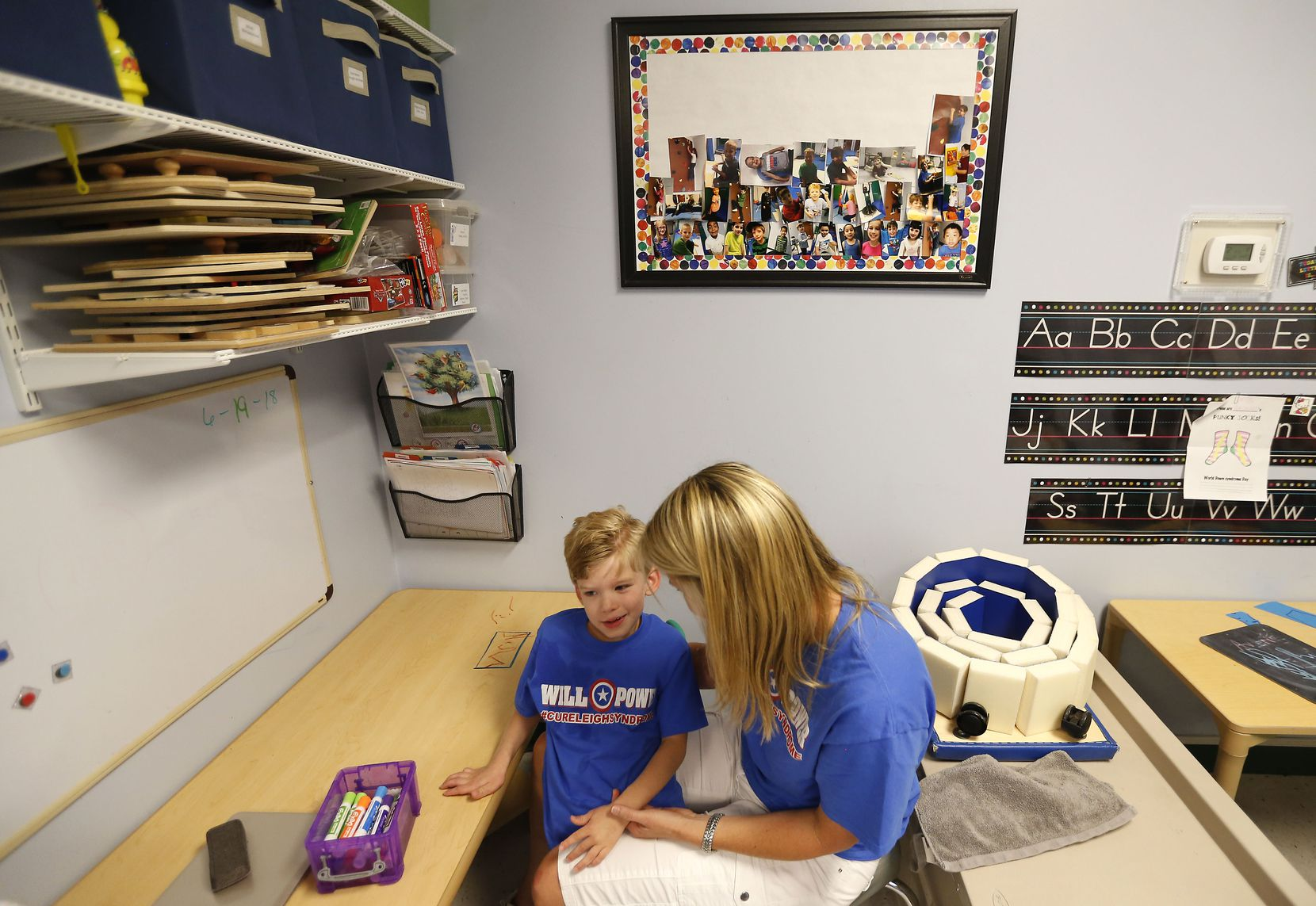 Occupational Therapy specialist Julie Bayless works with Will at Keystone Pediatric Therapy in McKinney, Texas, on June 20, 2018.