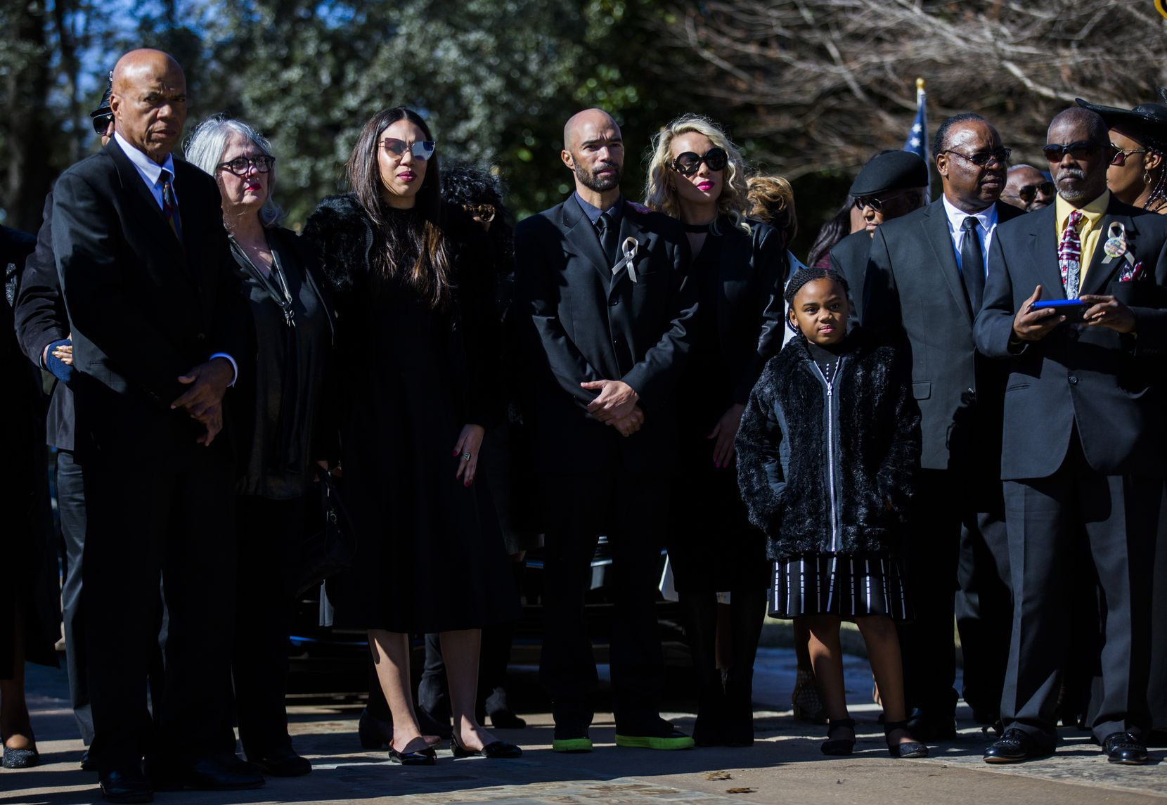 Family members wait as the remains of Richard Overton are transported to his grave site during a graveside service.