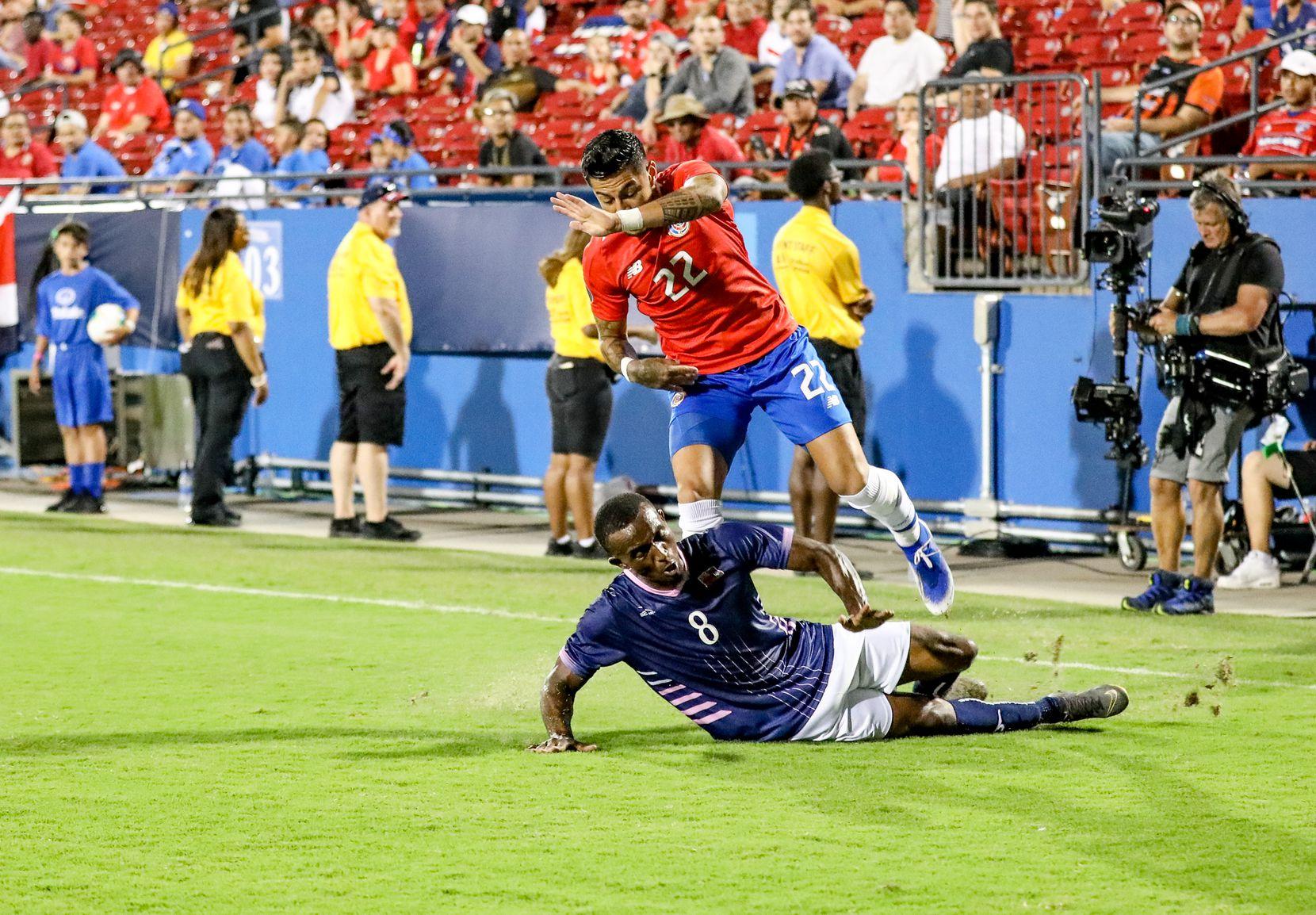 Bryan Oviedo of Bermuda tackles Costa Rica's Ronald Matarrita in the 2019 Gold Cup at Toyota Stadium. (6-20-19)