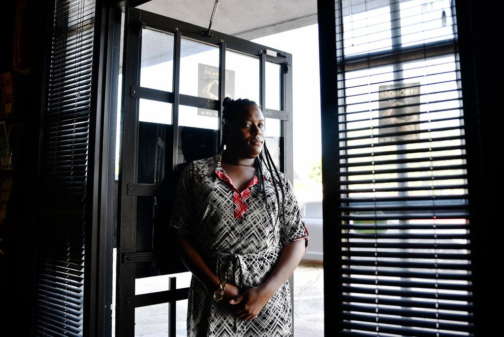 Naomi Green, a transgender woman, is shown at her place of work at Abounding Prosperity Inc. in Dallas. The agency serves the black LGBTQ community.