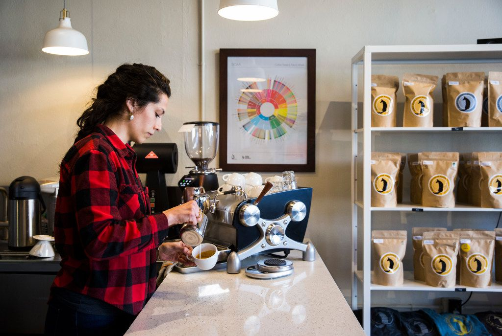 Bar manager Tiffany McAnarney makes a cappuccino at Noble Coyote Coffee Roasters across the street from Fair Park on Friday, January 20, 2017 on Exposition Avenue in Dallas.