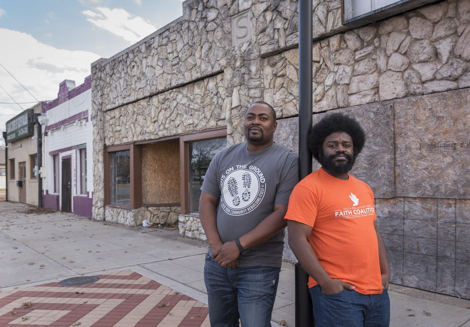 Jay Scroggins, left, and George Battle III plan to open the Fair Park District Entrepreneur Center in the building in the background at Martin Luther King Jr. Blvd. and Malcolm X Blvd.  The goal of the center is to provide tools to local residents who would like to start or grow their business.