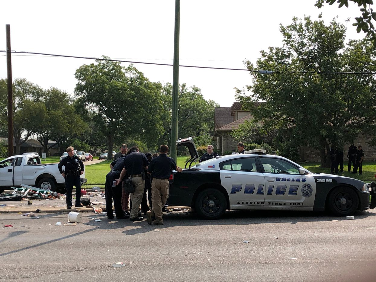 Investigators surrounded the squad car involved in the crash at Marsh Lane and Townsend Drive.