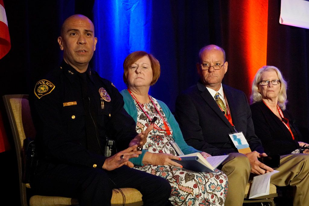 Dallas Police Department Assistant Chief Jason Rodriguez speaks during a panel discussion at the Dallas ISD School Safety Conference at the Omni Mandalay Hotel in Irving, Texas on Monday, July 22, 2019 with Mount Calm ISD superintendent James Wright II (second right) looking on.