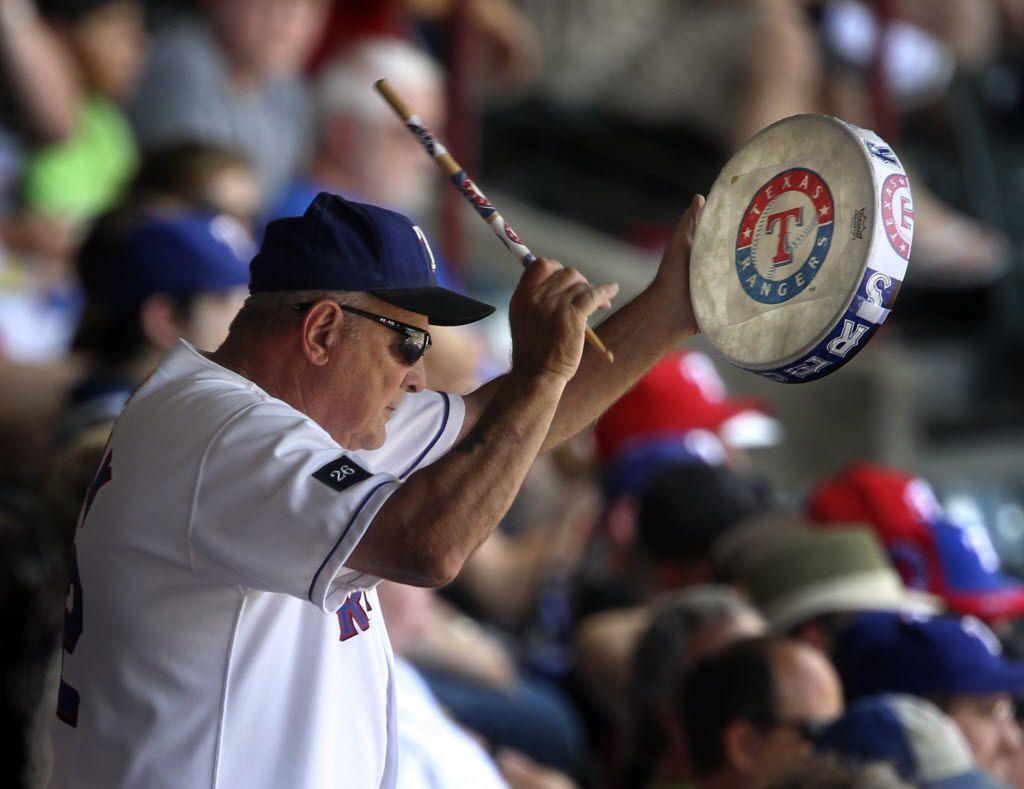"John Lanzillo, Jr., AKA ""Zonk"" (the Ranger's Super fan) cheers on a Rangers rally during the Houston Astros vs. the Texas Rangers major league baseball game at Rangers Ballpark in Arlington on Saturday, June 26, 2010.  (Louis DeLuca/The Dallas Morning News)"