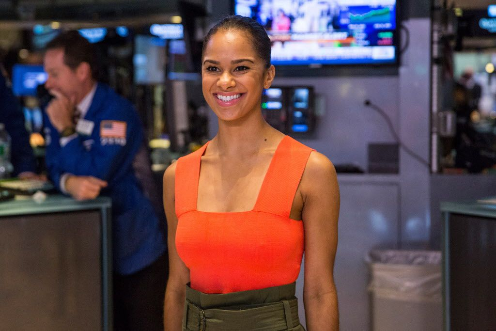 Ballet star Misty Copeland poses for photos on the floor of the New York Stock Exchange before ringing the closing bell on Monday.Copeland is the principal dancer for the American Ballet Theatre and the model for the joint project announced Wednesday by Dallas Black Dance Theatre and the American Ballet Theatre. (Photo by Andrew Burton/Getty Images)