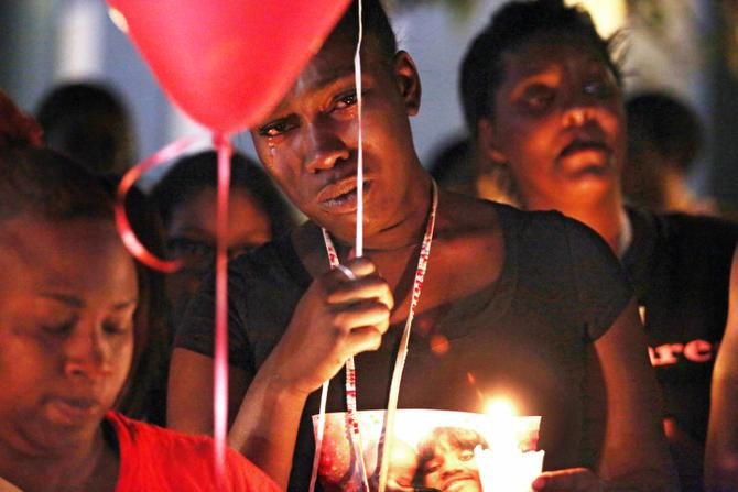 Naomi Thompson mourned the death of her friend, Marietta Shaw, at a candlelight vigil at Shaw's apartment complex on Friday night. Another friend, Myleka Senegal, described Shaw as a hard worker who had recently gone back to school.