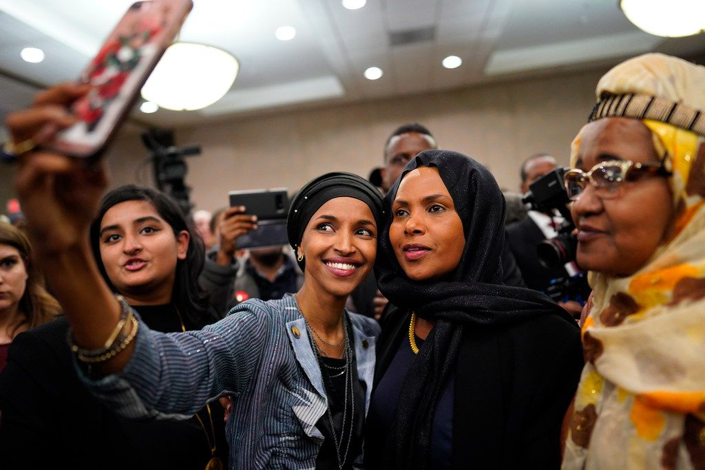 Ilhan Omar (left) poses for selfies with supporters after her victory Nov. 6, 2018, in Minneapolis. Omar is poised to become the first Somali-American elected to Congress, representing Minnesota's Fifth District.