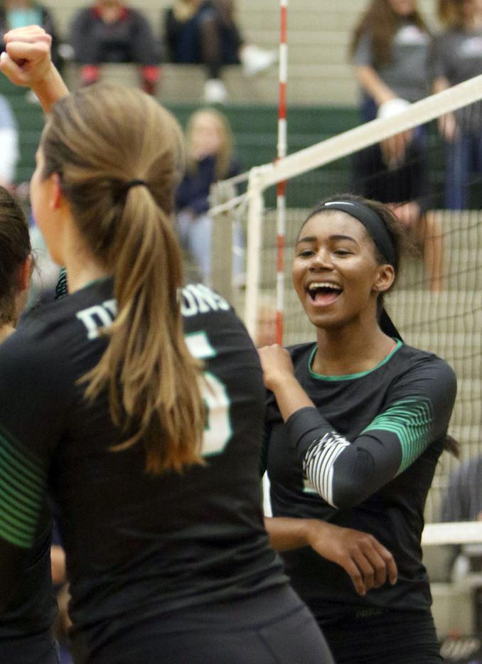 Southlake Carroll's Asjia O'Neal (7) was all smiles after scoring during the second set of play against Allen. Southlake won three straight sets. The two teams played their Class 6A Region l quarterfinal volleyball game at Lake Dallas High School in Corinth on November 8, 2016. (Steve Hamm/Special Contributor)