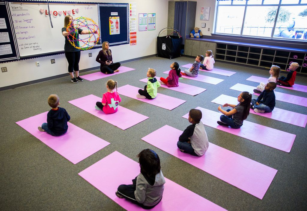 Coach Kristina Cappe (top left) teaches yoga concepts to the youngsters.