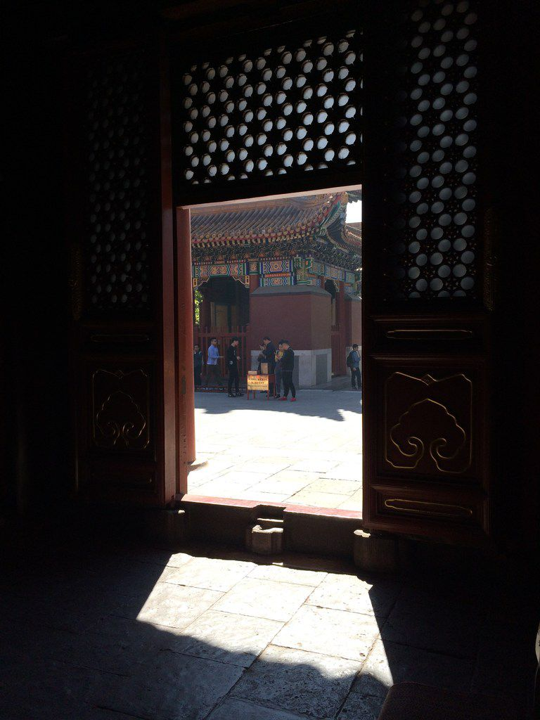 A threshold at the Yonghe Temple in Beijing provides a play of shadow and light.