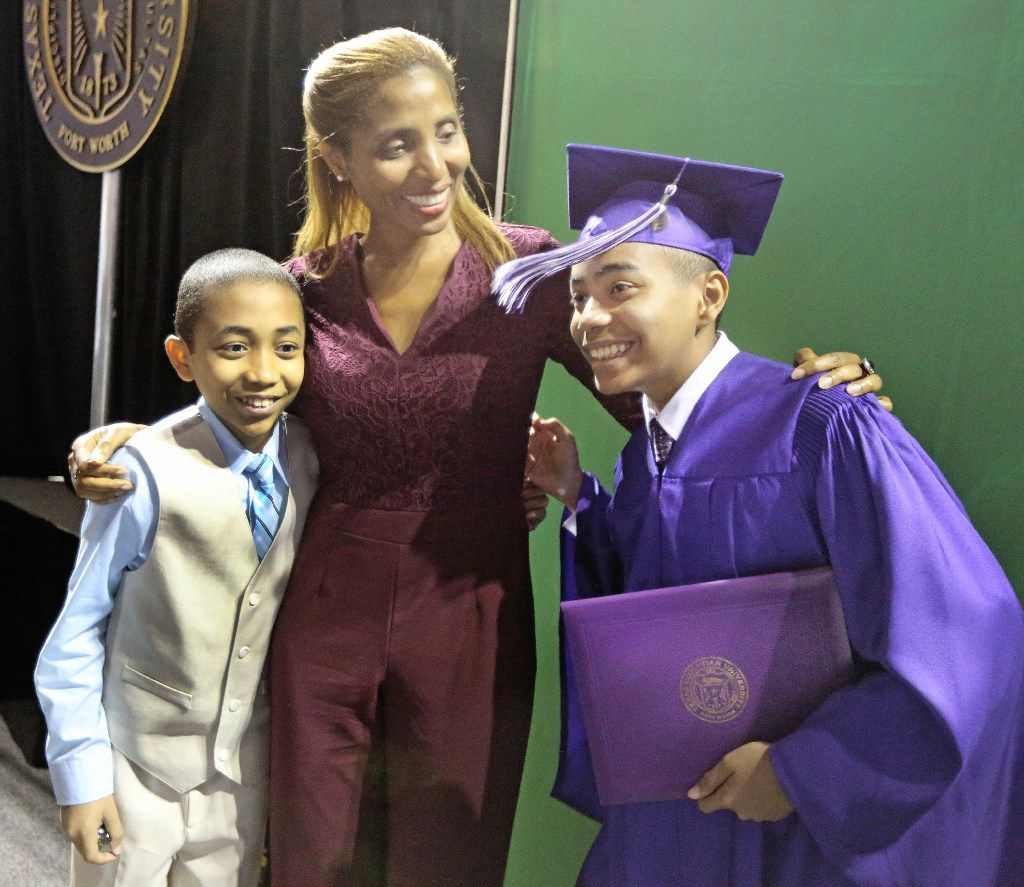 14-year-old Carson Huey-You, right, is all smiles with his mother Claretta and brother Cannan after receiving a bachelor's degree in physics TCU commencement. (Louis DeLuca/Dallas Morning News)