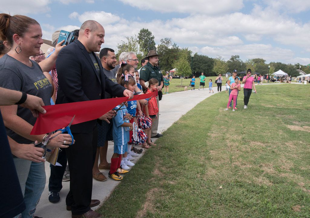 Dallas City Council Member Adam Medrano cuts a ribbon during the grand opening of Buckner Park on Saturday, Oct. 7, 2017. The park went though a 3 million dollar upgrade.