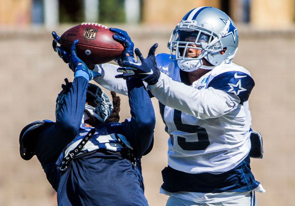 Dallas Cowboys cornerback Donovan Olumba (32) intercepts a pass intended for wide receiver Devin Smith (15) during an afternoon practice at training camp in Oxnard, California on Thursday, August 1, 2019. (Ashley Landis/The Dallas Morning News)