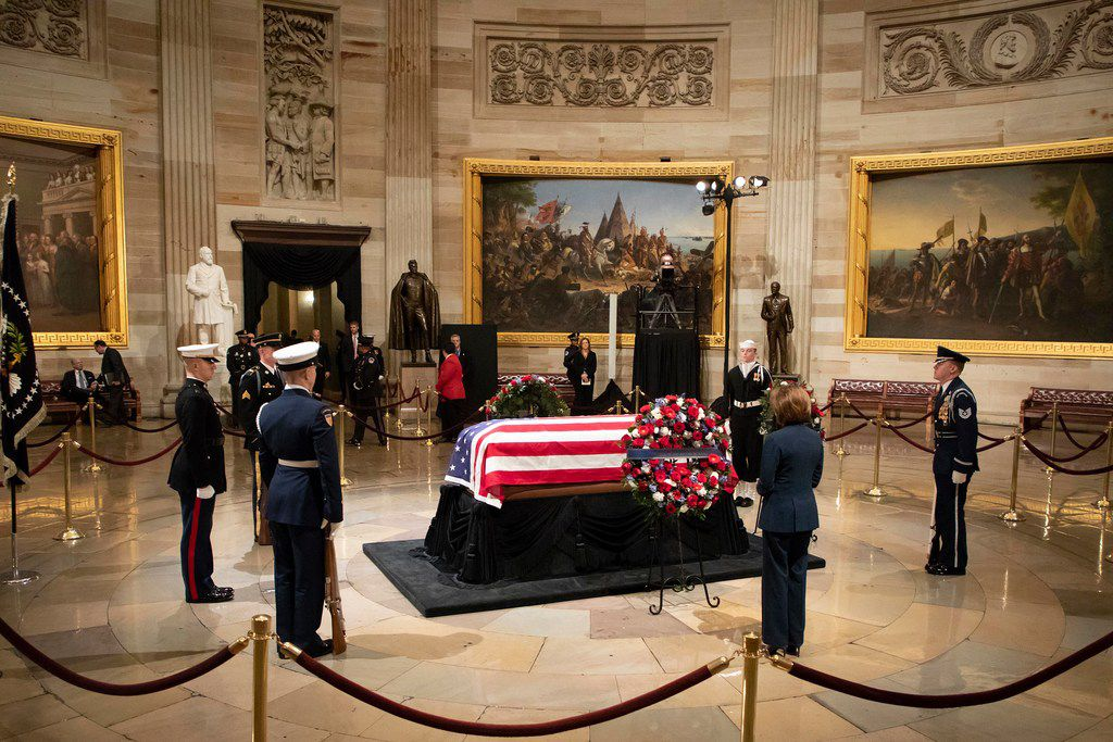 House minority leader Nancy Pelosi pays her respects to the President George H.W. Bush as he lies in the Rotunda of the U.S. Capitol on Tuesday, Dec. 4, 2018, in Washington.