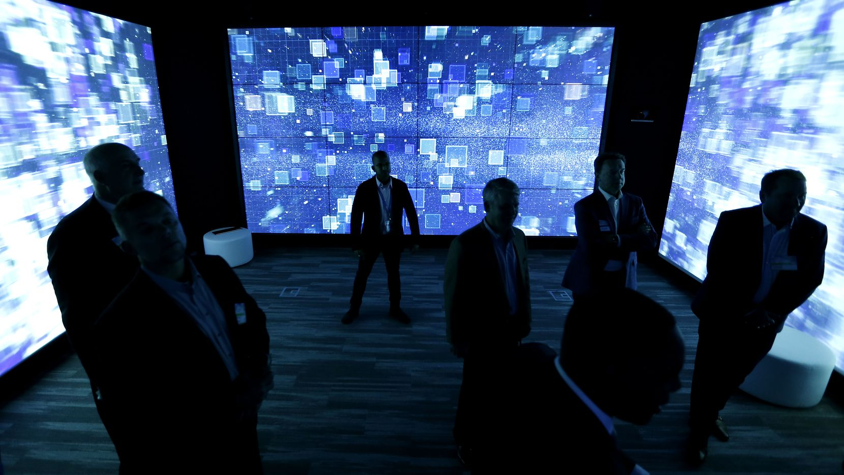 "Guests get a 360-degree experience utilizing touchscreen technology and high-definition projection inside the ""X Room"" of the Collaboration Center during an open house event at NTT Data's North American headquarters in Plano, Texas, Wednesday, Nov. 15, 2017. (Jae S. Lee/The Dallas Morning News)"
