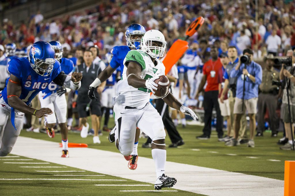 North Texas running back Antoinne Jimmerson (22) races for the end zone past SMU linebacker Jonathan Yenga (1) on a 25-yard touchdown run during the second half of an NCAA football game at Ford Stadium on Saturday, Sept. 12, 2015, in Dallas. (Smiley N. Pool/The Dallas Morning News)