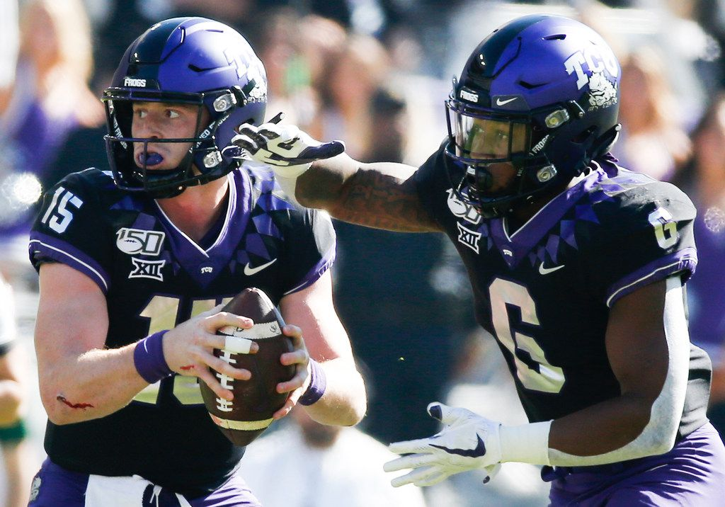 TCU Horned Frogs quarterback Max Duggan (15) hands off to TCU Horned Frogs running back Darius Anderson (6) during the first half of an NCAA football matchup between the Texas Christian University Horned Frogs and the Baylor Bears at Amon G. Carter Stadium in Fort Worth, Texas, on Saturday, No. 9, 2019. (Ryan Michalesko/The Dallas Morning News)
