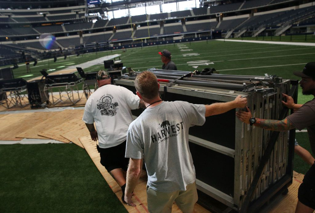 Harvest crew member Tim Blaney (bottom center) helps move equipment as crews setup for Harvest America at AT&T Stadium in Arlington, Texas Thursday June 7, 2018. Harvest America is Sunday night June 10, 2018. The Christian evangelistic outreach event includes top Christian music artists and a message form pastor Greg Laurie. (Andy Jacobsohn/The Dallas Morning News)
