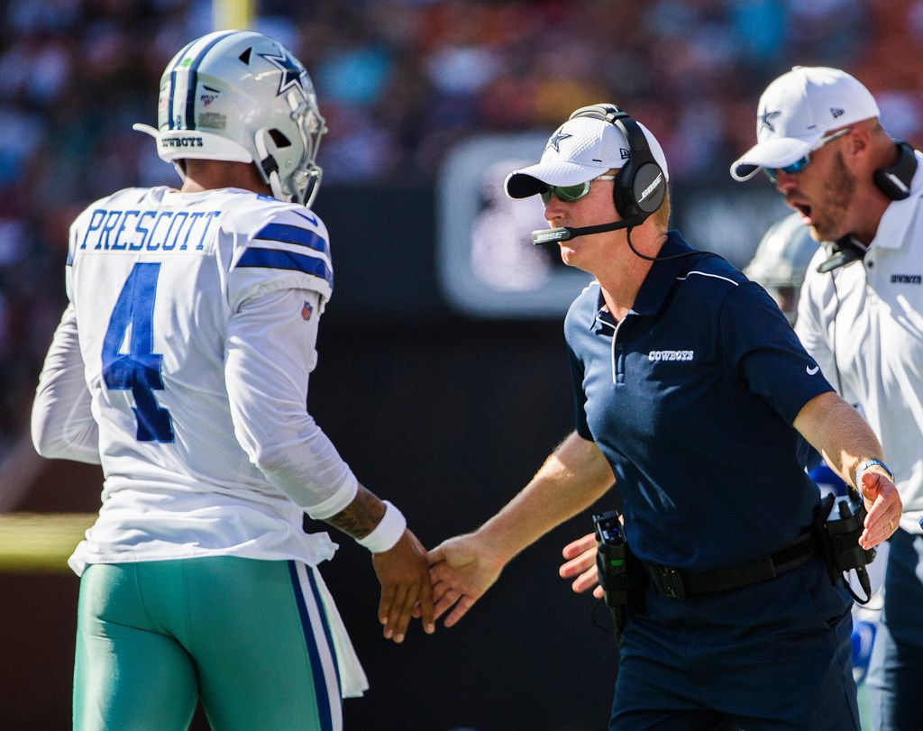 Dallas Cowboys quarterback Dak Prescott (4) high fives head coach Jason Garrett after a touchdown during the first quarter of an NFL preseason game between the Dallas Cowboys and the Los Angeles Rams on Friday, August 17, 2019 at Aloha Stadium in Honolulu, Hawaii. (Ashley Landis/The Dallas Morning News)