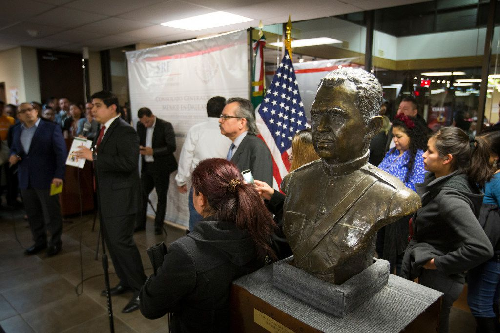 A bust of former Mexican President Lazaro Cardenas sits next to the speakers during a community meeting on possible deportations at the Consulate General of Mexico on Thursday, Feb. 16, 2017, in Dallas. (Smiley N. Pool/The Dallas Morning News)