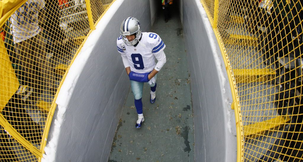 Dallas Cowboys quarterback Tony Romo (9) walks out of the tunnel to face the Green Bay Packers in the NFC Divisional playoff at Lambeau Field in Green Bay Wisconsin, Sunday, January 11, 2015. (Tom Fox/The Dallas Morning News)