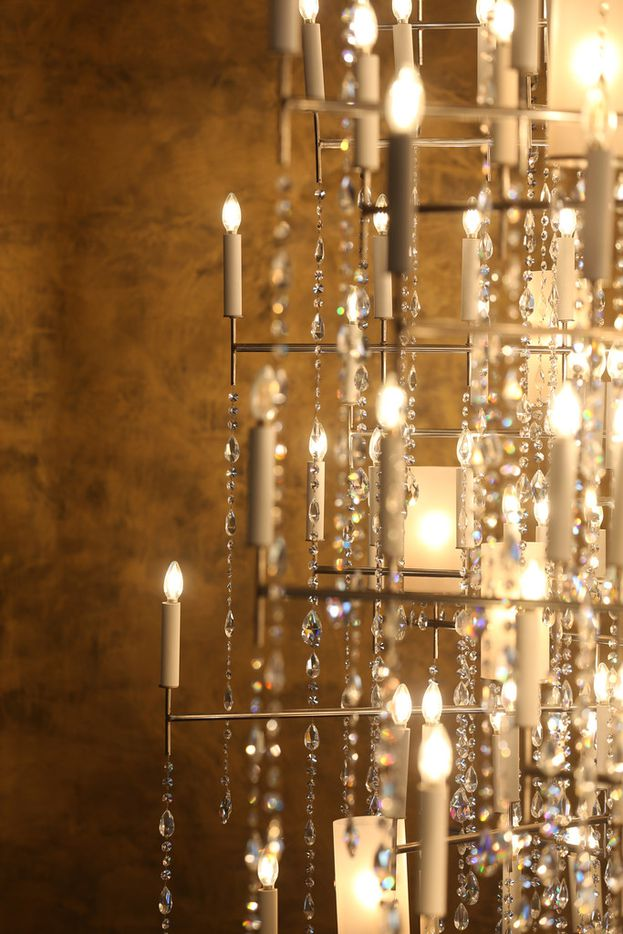 "A chandelier against a gold wall inside Travis and Stephanie Hollman's home in Dallas on Thursday, Feb. 21, 2019. Stephanie is a cast member on ""The Real Housewives of Dallas"". (Rose Baca/Staff Photographer)"