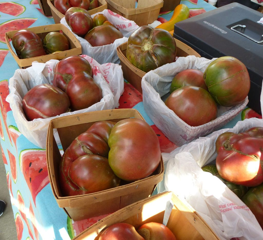 Imperfect but delicious Purple Cherokee tomatoes are part of the Baugh Farms harvest at St. Michael's Farmers Market.
