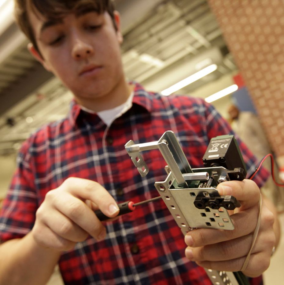 Tyler Gassman, 17, works on a project in a robotics class at Lovejoy High School in Lucas. (Jason Janik/Special Contributor)