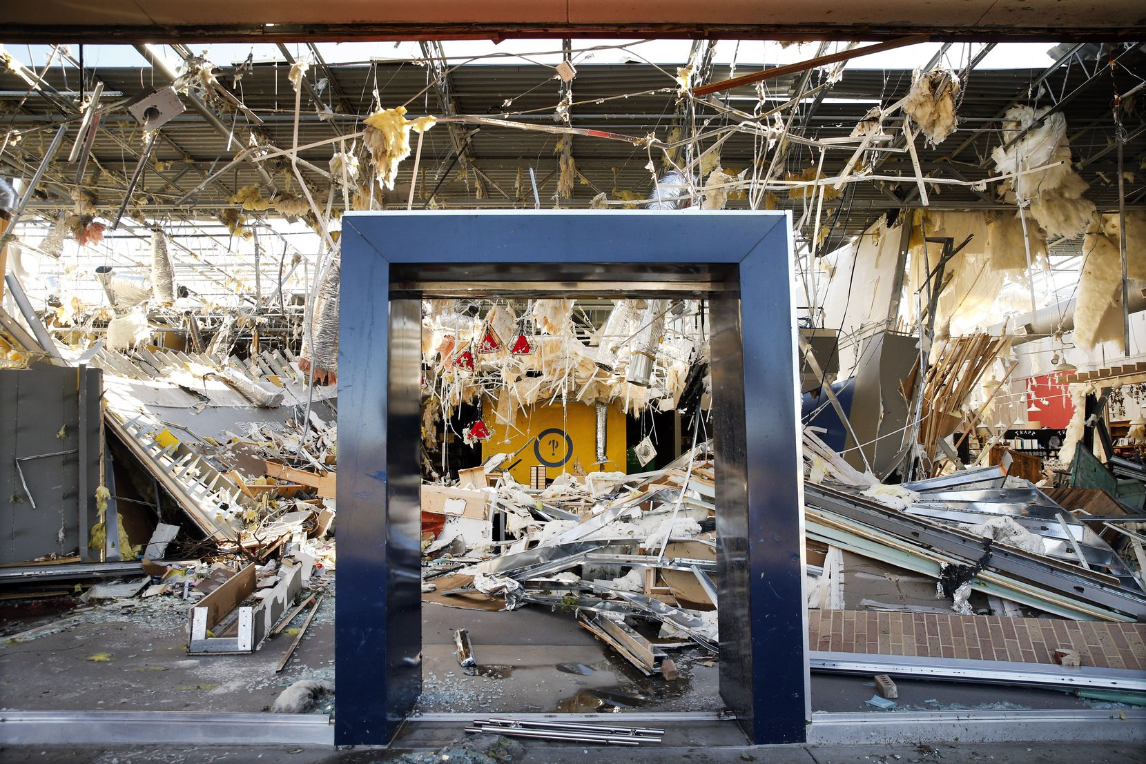 The interior of the Interabang Books store was demolished by a tornado Sunday night in the Preston Royal shopping center in Dallas.